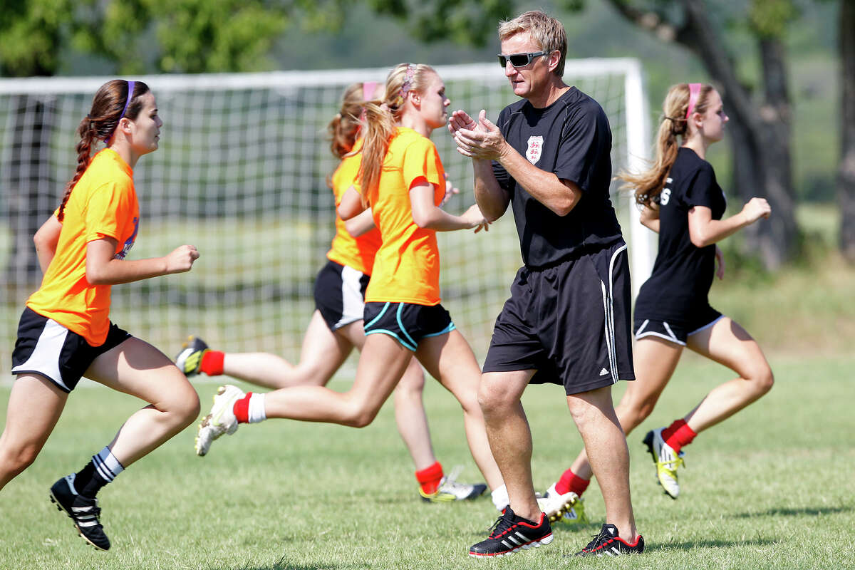 Lions FC '96 coach Peter Moore (second from right) works with the team during a practice session at Lions Pride Park on Tuesday, July 2, 2013. The club, based in San Antonio and consisting of high school players who will be seniors in the fall, will compete in the four-team U.S. Youth Soccer National Presidents Cup on Thursday through Sunday at the Lake Myrtle Sports Complex in Auburndale, Fla. The squad is believed to be the first from San Antonio to qualify for a national soccer tournament.Read more about the team on ExpressNews.com.