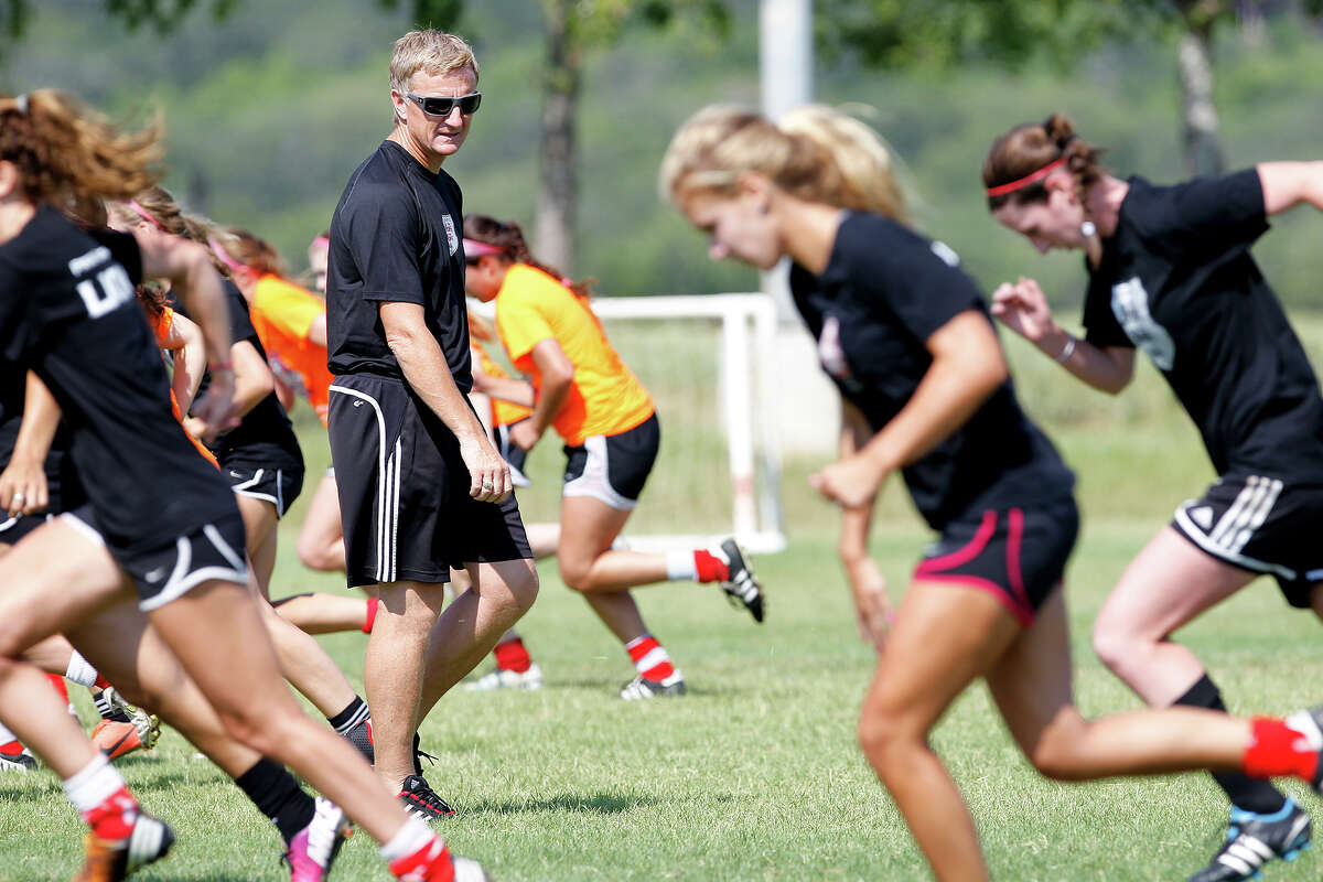 Lions FC '96 coach Peter Moore works with the team during a practice session at Lions Pride Park on Tuesday, July 2, 2013.