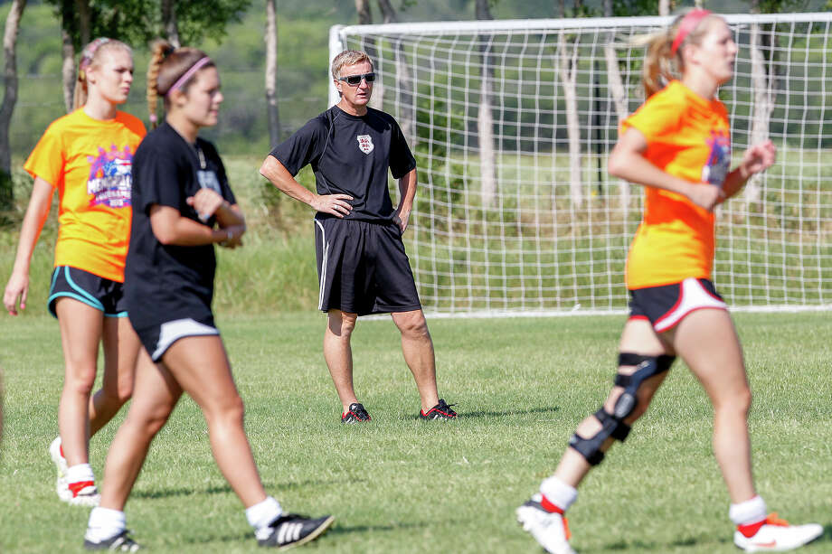 Lions FC '96 coach Peter Moore (center) works with the team during a practice session at Lions Pride Park  on Tuesday, July 2, 2013. Photo: Marvin Pfeiffer, San Antonio Express-News / Express-News 2013
