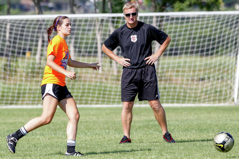Lions FC '96 coach Peter Moore (right) works with the team during a practice session at Lions Pride Park on Tuesday, July 2, 2013. Photo: Marvin Pfeiffer, San Antonio Express-News / Express-News 2013