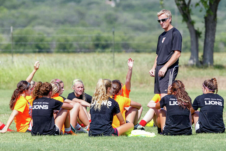 Lions FC '96 coach Peter Moore talks to the team following a practice session at Lions Pride Park on Tuesday, July 2, 2013. Photo: Marvin Pfeiffer, San Antonio Express-News / Express-News 2013