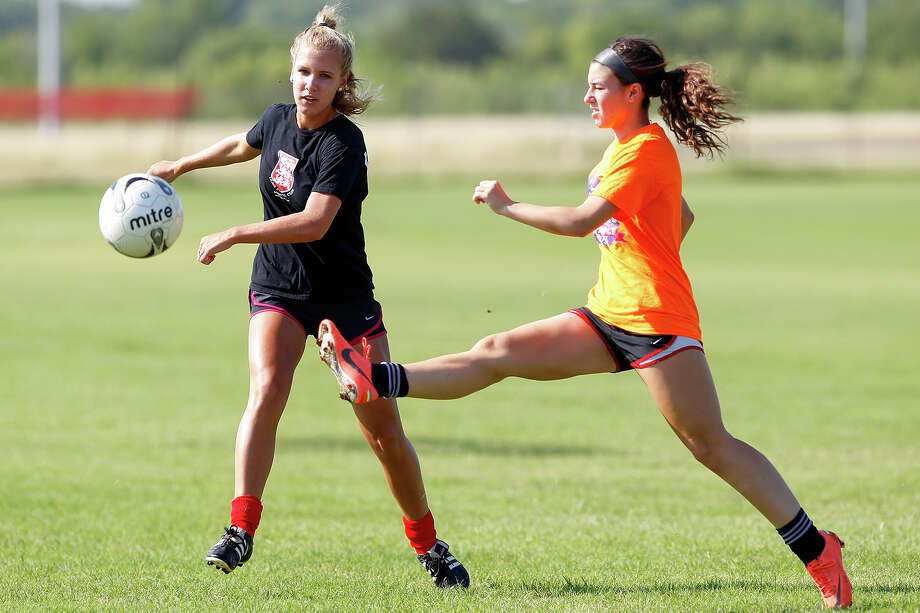 Brooke Shoffstall (left) advances the ball as Rachel Gurinsky tries to stop her during a Lions FC '96 practice session at Lions Pride Park  on Tuesday, July 2, 2013.  Photo: Marvin Pfeiffer, San Antonio Express-News / Express-News 2013