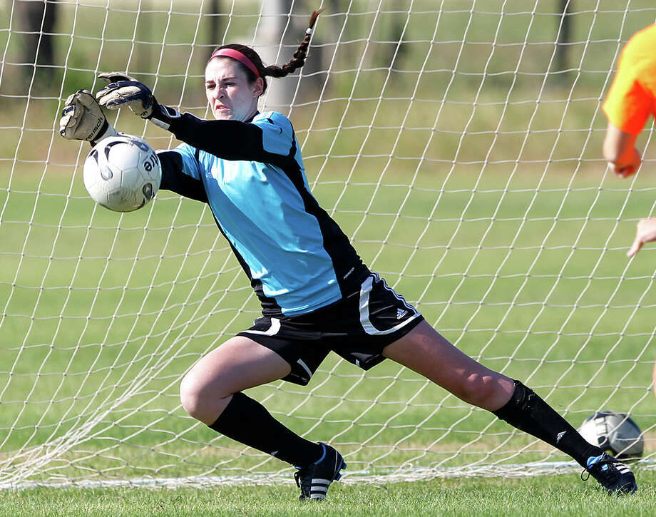 Goalie Kelly Marshall makes a save during a Lions FC '96 practice session at Lions Pride Park on Tuesday, July 2, 2013. Photo: Marvin Pfeiffer, San Antonio Express-News / Express-News 2013