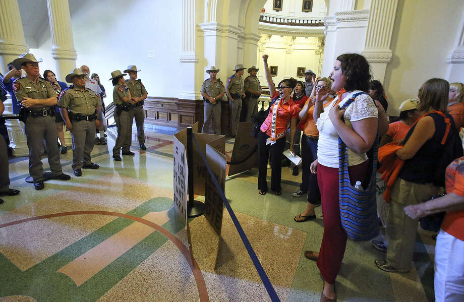 With DPS troopers keeping a watchful eye on them, pro-abortion-rights protesters demonstrate against the legislation. The Texas abortion restrictions would prohibit the procedures after 20 weeks. Photo: Tom Reel / San Antonio Express-News