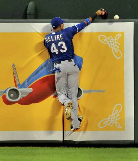 Rangers center fielder Engel Beltre can't catch a ball hit by the Orioles' Brian Roberts in the fourth inning. Photo: McClatchy-Tribune News Service