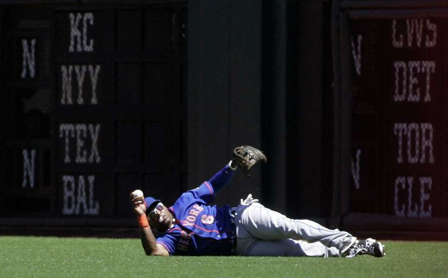 Marlon Byrd robs Mike Kickham of a hit. He also homered in the Mets' sweep of the Giants. Photo: Karl Mondon / Contra Costa Times