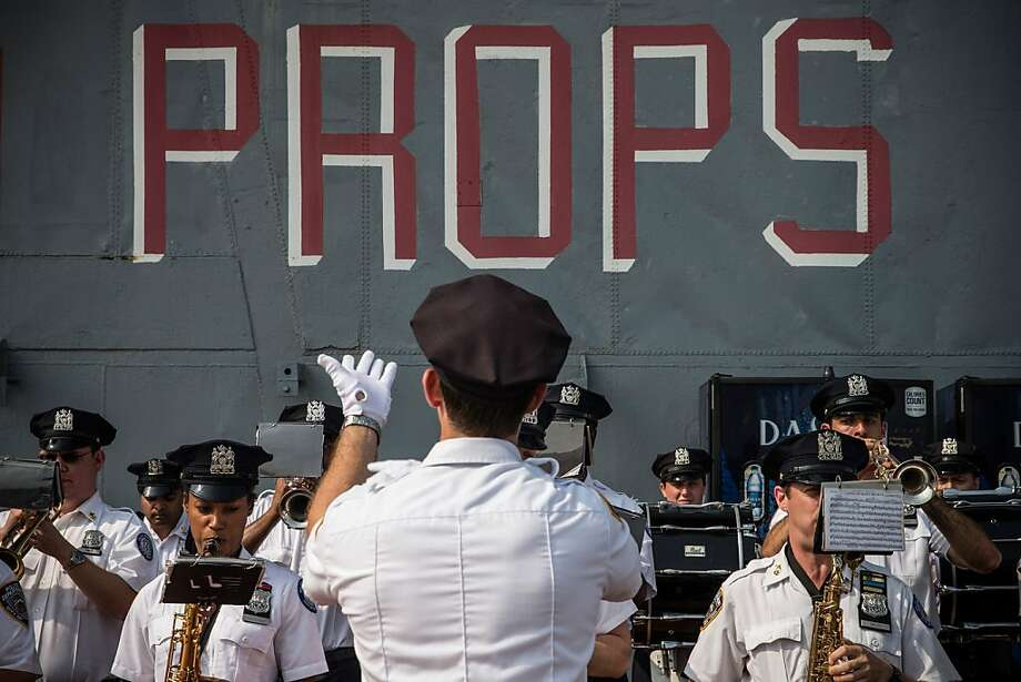 NEW YORK, NY - JULY 10:  The New York Police Department (NYPD) Marching Band plays at the re-opening of the Space Shuttle Enterprise's Pavilion housing on the flight deck of the Intrepid Sea, Air and Space Museum on July 10, 2013 in New York City. The shuttle's original housing was damaged in October 2012 from Superstorm Sandy, and has been closed since then.  (Photo by Andrew Burton/Getty Images) Photo: Andrew Burton, Getty Images