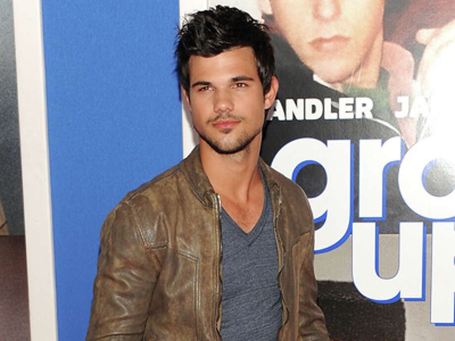 "Actor Taylor Lautner attends the premiere of ""Grown Ups 2"" at the AMC Loews Lincoln Square on Wednesday, July 10, 2013 in New York. Photo: Evan Agostini, Evan Agostini/Invision/AP / Invision"