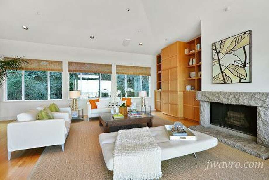 Living room with views, fireplace. Photos via J Wavro/Trulia.