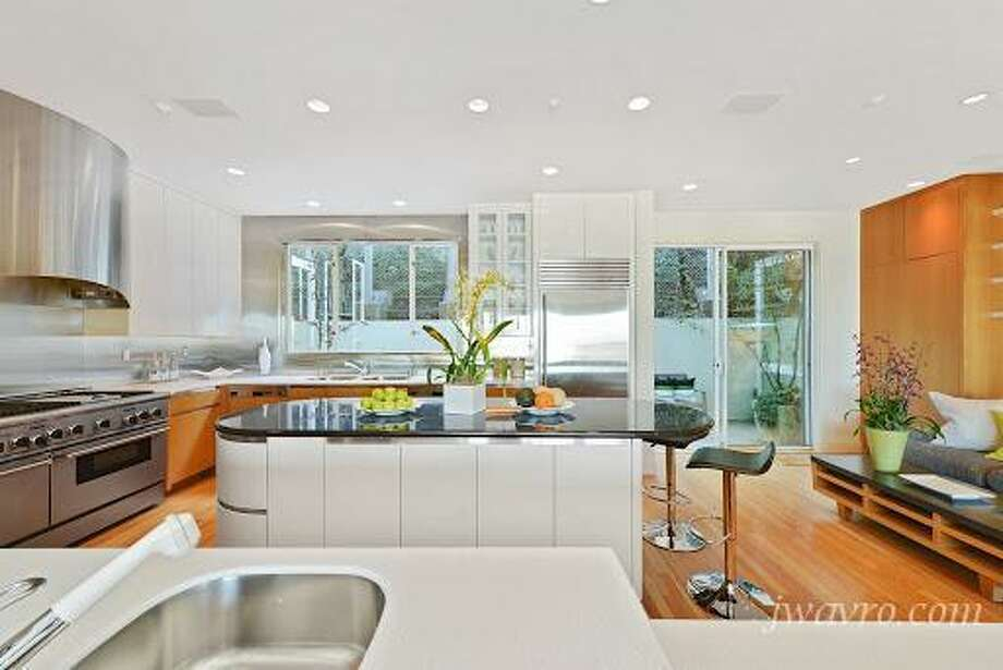 Kitchen area. Photos via J Wavro/Trulia.
