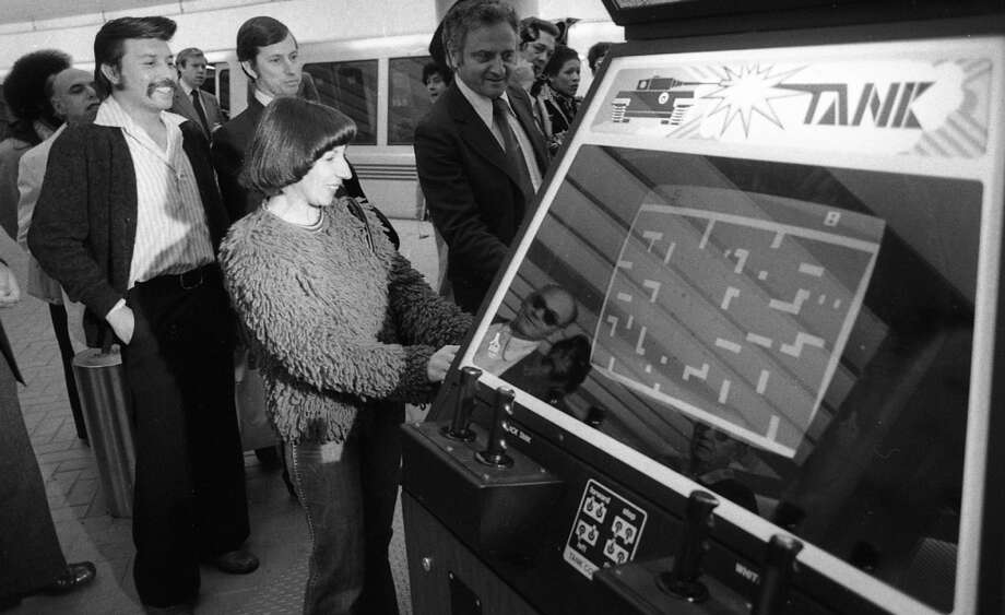 Dec. 7, 1976: Atari and BART entered into a strange partnership, agreeing to split the profits for these video games. The crowd is from central casting -- you don't get more 1976 than a shag rug sweater.