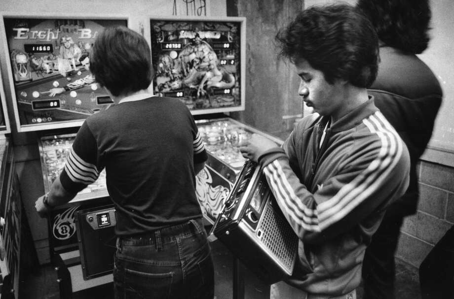Oct. 11, 1978: I'm sad this is the only Musee Mecanique photo I could find. It's a checklist for 1978 fashion. Adidas track suit! Feathered hair! Boom box with cassette deck and mono sound!