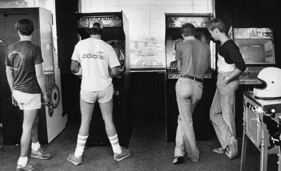 Aug. 21, 1981: Kids play video games at Greenbrae Bowl, wearing the 1981 uniform of short shorts and athletic tube socks. I hope the dude on the right wore the helmet while playing Stunt Cycle. And can we assume the guy second-from-the-left broke his left arm during a Berzerk-related injury?