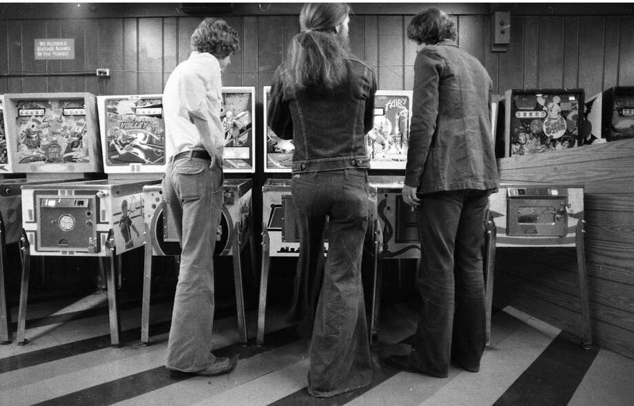 Jan. 28, 1977: The 1970s, one of the greatest eras for both pinball and pants. You could make an entire second and third pair of jeans from the extra fabric in this guy's bell bottoms.