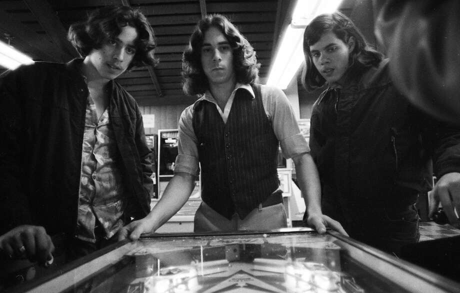 Jan. 28, 1977: Maybe it's not his dad, but that's definitely a Lincecum. Note the balletic way that he plays pinball. I love the fashion here -- especially Tim Sr.'s vest & the Derby jacket.