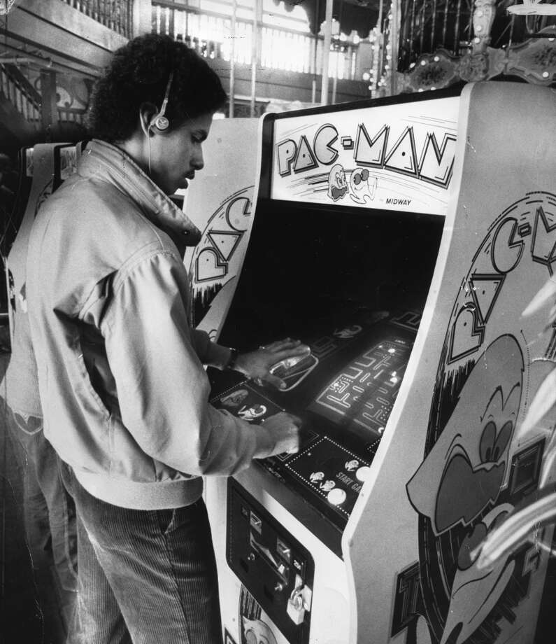 "March 16, 1982: This kid hits the 1980s trifecta -- with a cassette Walkman, Member's Only jacket and Pac-Man. The photo was taken at Pier 39 for a story about the song ""Pac-Man Fever."""