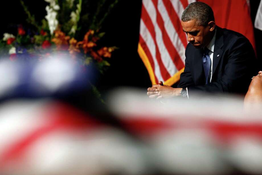 President Barack Obama attends the memorial for firefighters killed at the fertilizer plant explosion in West. The president should honor his commitment and provide additional FEMA funds for disaster victims. Photo: Charles Dharapak, Associated Press / AP