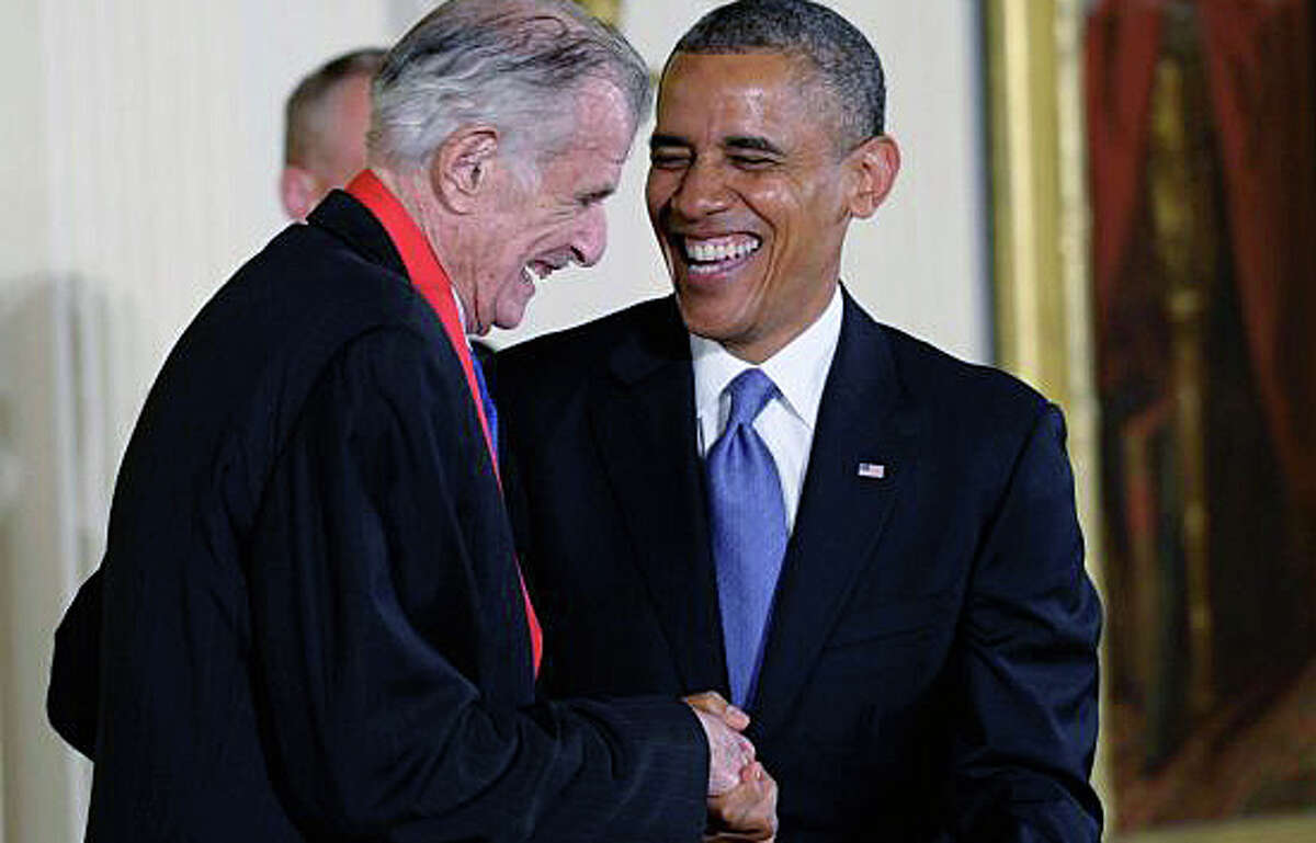 President Barack Obama shares a laugh with sports writer and novelist Frank Deford, after presenting him with the 2012 National Humanities Medal during a ceremony Wednesday in the East Room of White House in Washington, DC.