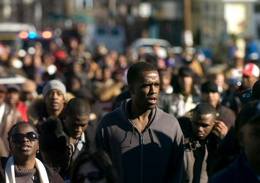 Marchers head up West Main St. during the Annual MLK March in Stamford, Conn. on Monday, Jan. 18, 2010.