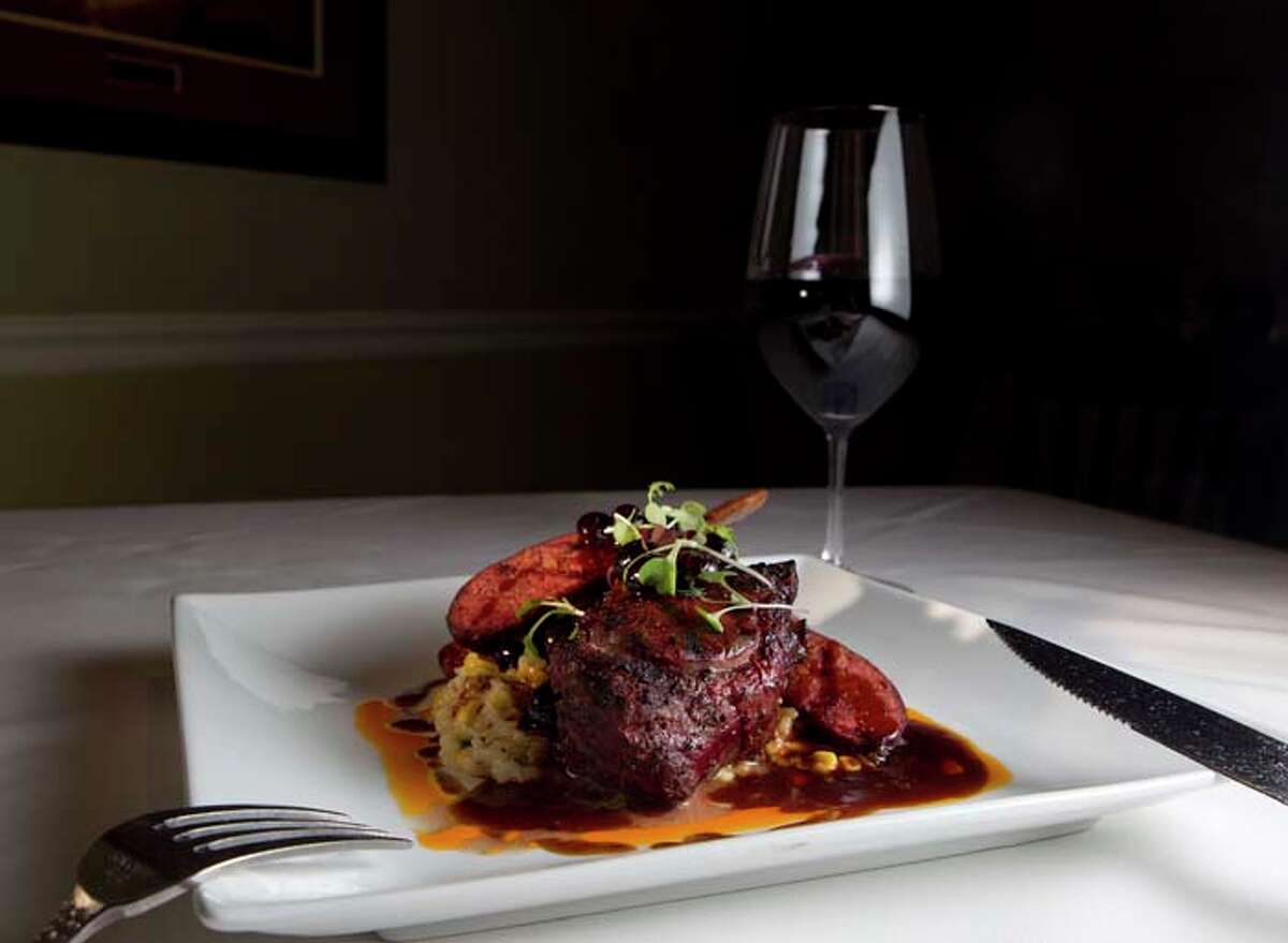 The Broken Arrow Ranch Venison Chop with house made blueberry sausage and sweet corn Rissoto at Killen's Steakhouse