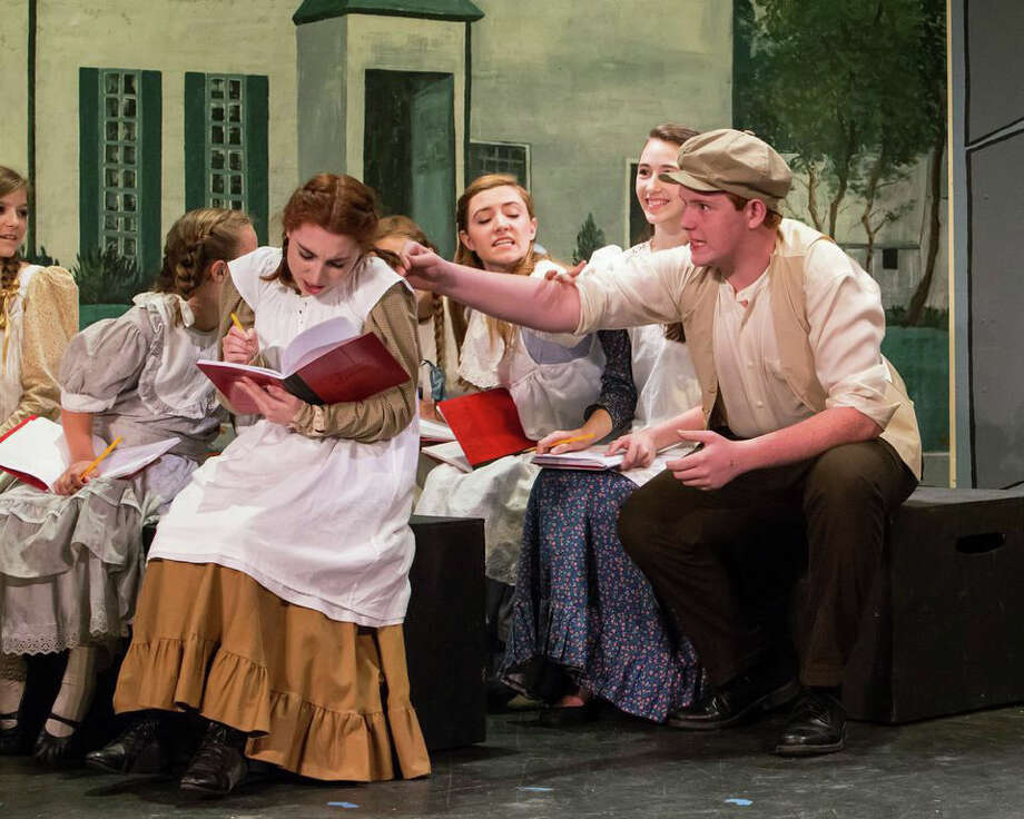 """Anne of Green Gables"" is on stage at The Sherman Playhouse through July 27. Left to right are Emma Nissenbaum (seated with book), Erin Shaughnessy as Diana Barry, Jerusha Wright as Prissy Andrews,  and Sam Everett as Gilbert Blythe. Photo: Contributed Photo"
