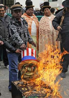 Protesters burn an effigy of US President Barack Obama as well as a coffin with flags of Spain, Portugal, France and Italy, during a demonstration outside the US embassy in La Paz on July 8, 2013 a week after Bolivian President Evo Morales's plane, flying home from a trip to Moscow last week, was forced to make an unscheduled stopover in Vienna after these four European nations temporarily closed their airspace over groundless rumours that fugitive US intelligence leaker Edward Snowden was aboard the jet. Snowden won support from Cuba for his bid to seek asylum in Latin America as he began his third week in limbo at a Moscow airport on Monday. Cuba, a key transit point from Russia on the way to Latin America, supported the leaders of Bolivia, Venezuela and Nicaragua, who have offered the 30-year-old a possible lifeline as he remains marooned without documents in the transit area of a Moscow airport.   AFP PHOTO / JORGE BERNALJORGE BERNAL/AFP/Getty Images