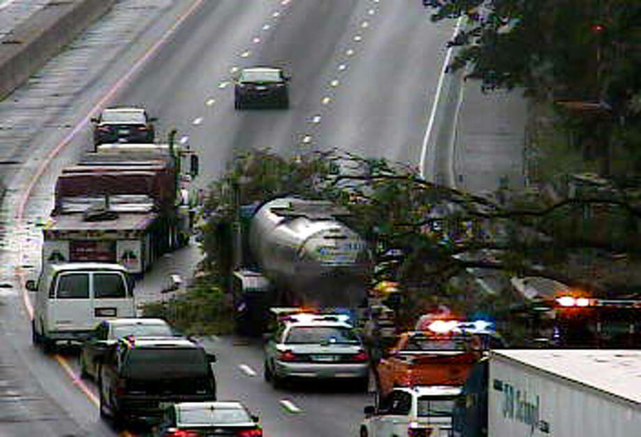 A fallen tree on the northbound lanes of I-95  between Exits 4 and 5 in Greenwich, caused massive delays Thursday July 11, 2013. Photo: Contributed Photo, Conn. DOT / Greenwich Time Contributed