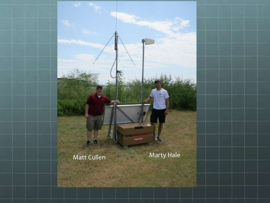 Matt Cullen, left, and Marty Hale, Texas A&M graduate students helped install a sensor in Galveston for the university's Lightning Mapping System. Photo: Texas A&M University