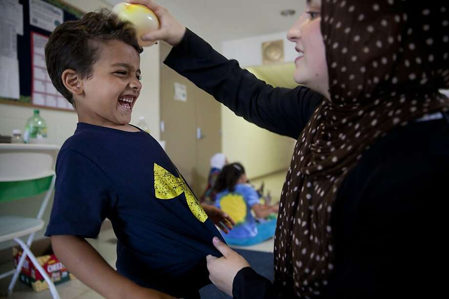 Celebrate Ramadan by sticking balloons to your head!K.C. Khirfan gives 5-year-old Jibreel a 