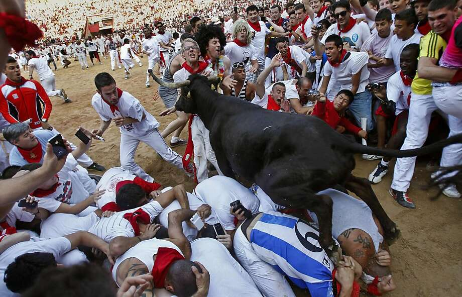Speed bump:When revelers are too slow to outrun the bulls of Pamplona, they are frequently run over by the bulls of Pamplona. Photo: Alvaro Barrientos, Associated Press