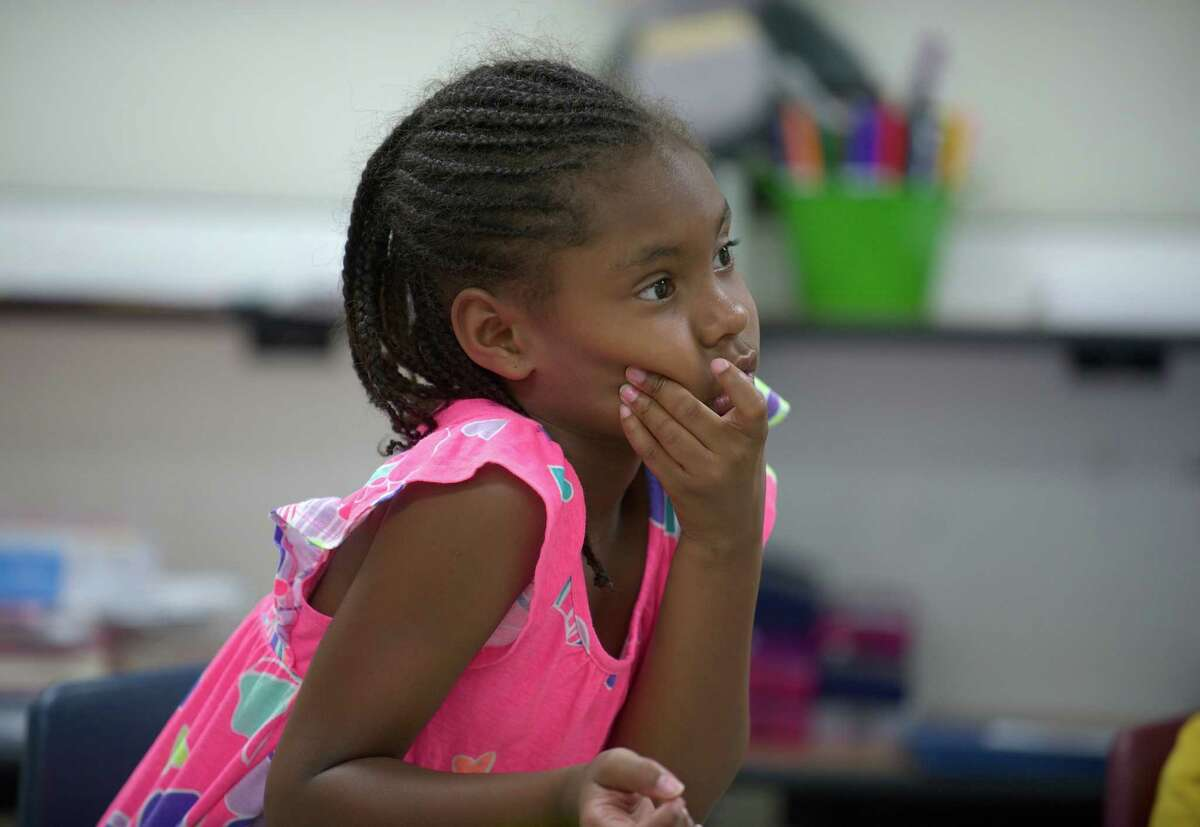 Dichelle Swift, age 6, listens to a question during