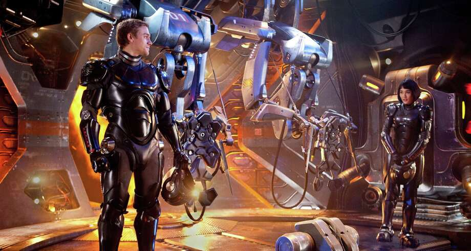 "This film image released by Warner Bros. Pictures shows Charlie Hunnam as Raleigh Becket, left, and Rinko Kikuchi as Mako Mori in a scene from ""Pacific Rim."" (AP Photo/Warner Bros. Pictures, Kerry Hayes) ORG XMIT: NYET101 Photo: Kerry Hayes / Warner Bros. Pictures"