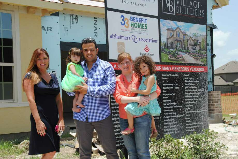 From left, Christine Gondron, sales consultant for Village Builders, and Amine Belmokadem and Lana Belmokadem and their two daughters, who purchased the Village Builders GHBA Benefit home a few weeks after the ground breaking.