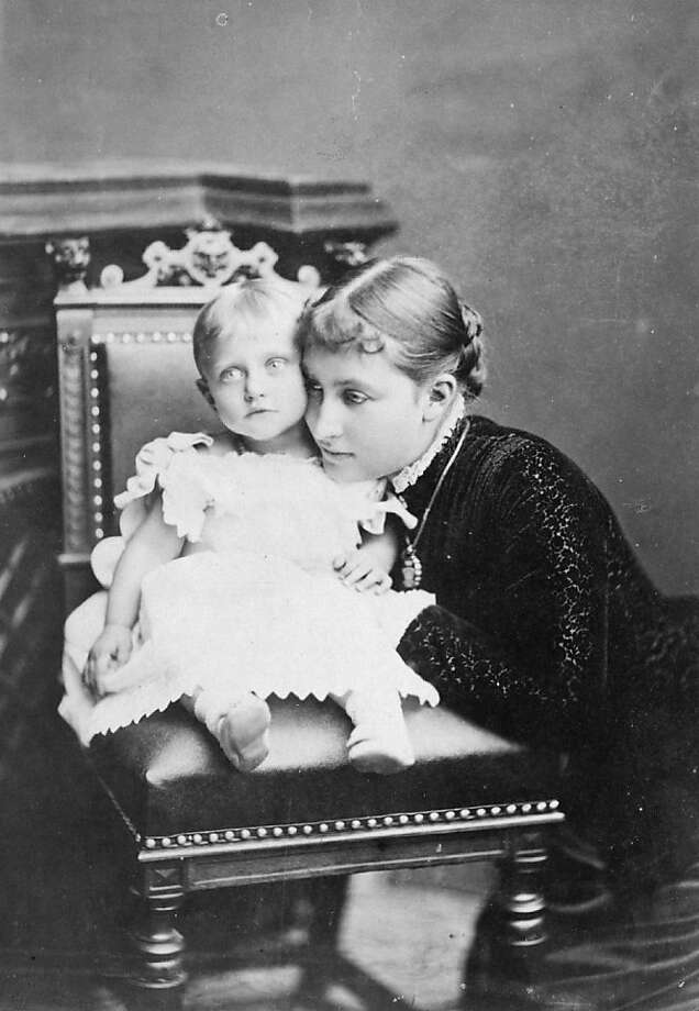 Princess Charlotte, daughter of Friedrich III, King of Prussia, (1860 - 1919), wife of Duke Bernhard of Saxe-Meiningen, with their child, circa 1880.  Photo: Hulton Archive