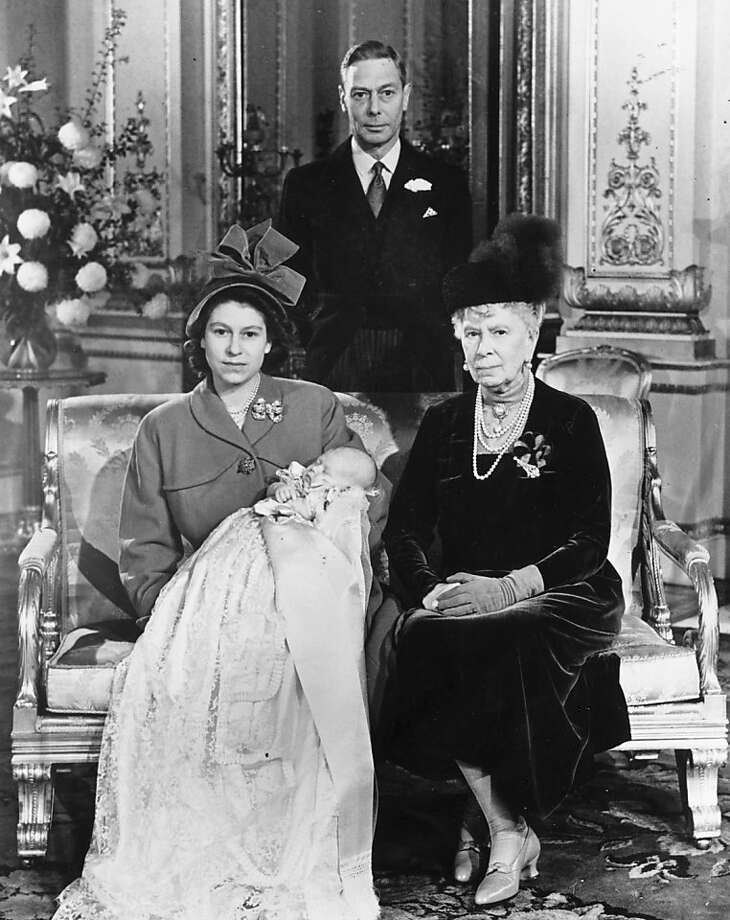 Princess Elizabeth holding her baby son Prince Charles after his christening ceremony at Buckingham Palace, London whilst King George VI (1895 -1952) stands behind her and Queen Mary (1863 - 1953) sit beside her on December 15, 1948. Photo: Keystone