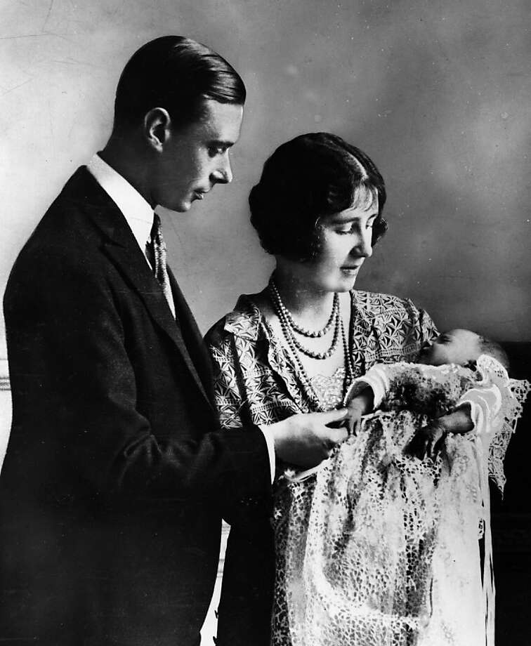 Future King and Queen, George, Duke of York (1895 - 1952) and Elizabeth Duchess of York (1900 - 2002) holding their first child, future Monarch Princess Elizabeth at her christening ceremony, May 1926.  Photo: Central Press