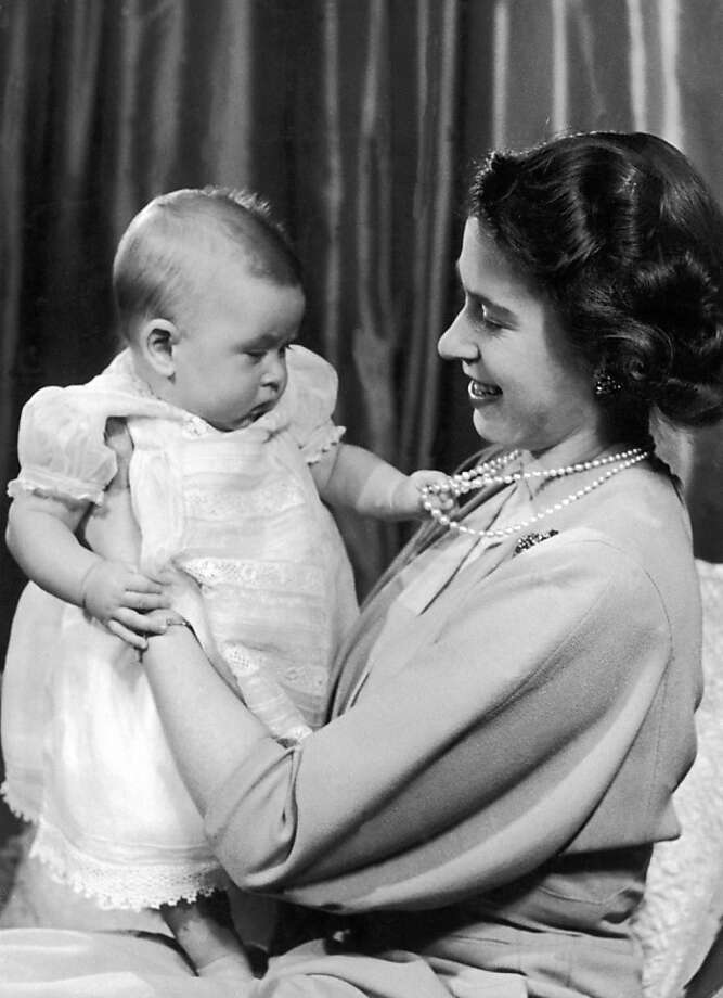 Princess Elizabeth II at play with her infant son Prince Charles. The picture was taken in Princess Elizabeth's private sitting room at Buckingham Palace on April 9, 1949. Photo: Keystone-France