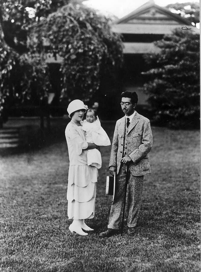 Emperor Hirohito of Japan (1901 - 1989) with his baby daughter Princess Shigeko (aka Teru no miya), December 1925. Photo: Keystone