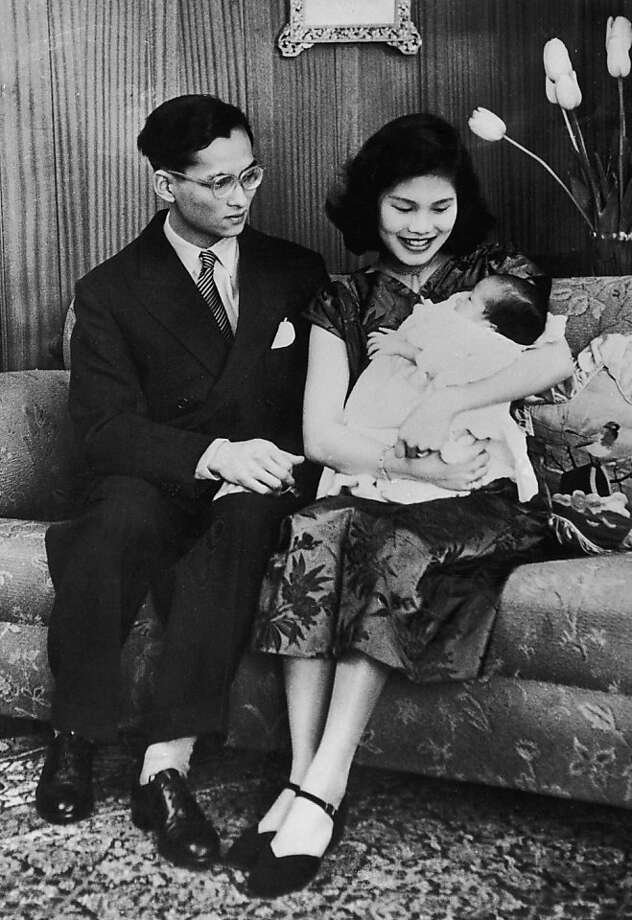 King Bhumibol and Queen Sirikit of Thailand with their new baby daughter, Princess Ubol Ratana, in Lausanne, May 2, 1951.  Photo: Keystone