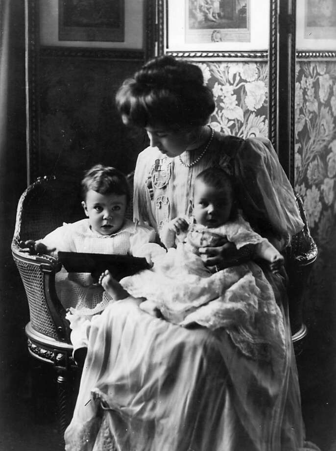 The Crown Princess of Sweden, Viktoria, (1862 - 1930), who in 1881 married King Gustav V of Sweden, then Crown Prince, who ascended the throne in 1907, with two of her children, circa 1885.  Photo: W. And D. Downey