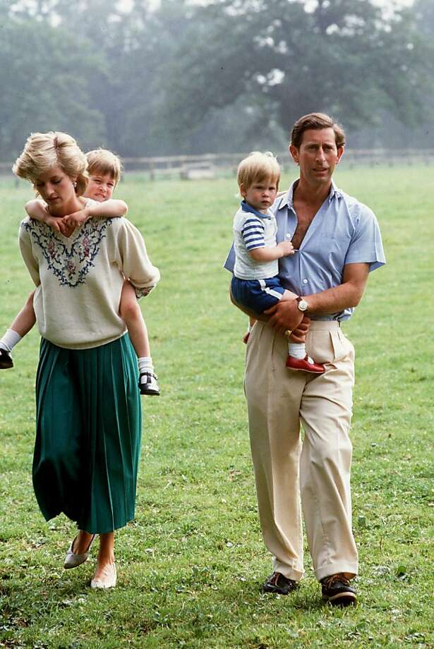 Prince Charles and Princess Diana with Prince William and Prince Harry at home in the gardens of Highgrove House. Photo: Tim Graham