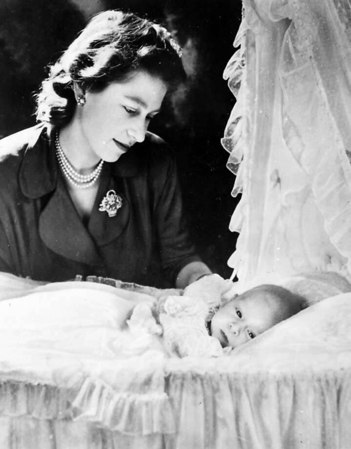 Prince Charles, the son of H.R.H, Princess Elizabeth and Duke of Edinburgh pictured at 5 weeks old, in December 1948, with his mother looking on.  Photo: Popperfoto