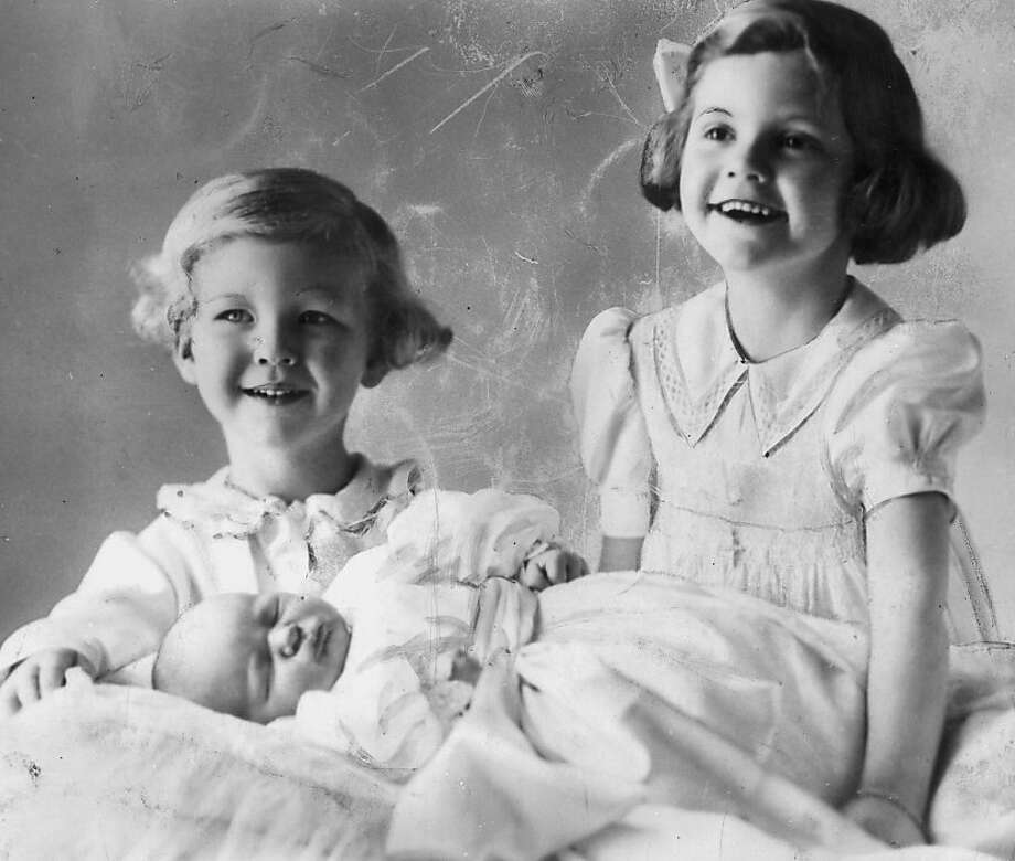 Prince Vittorio Emanuele and Princess Maria Pia of Savoy with their new baby sister, Princess Maria Gabriella, 1940.  Photo: Keystone