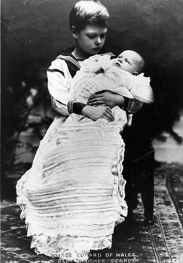 A 1903 image of Prince Edward, later King Edward VIII and the Duke of Windsor, holding his younger brother Prince George, who succeeded him to the throne following the abdication.  Photo: Keystone