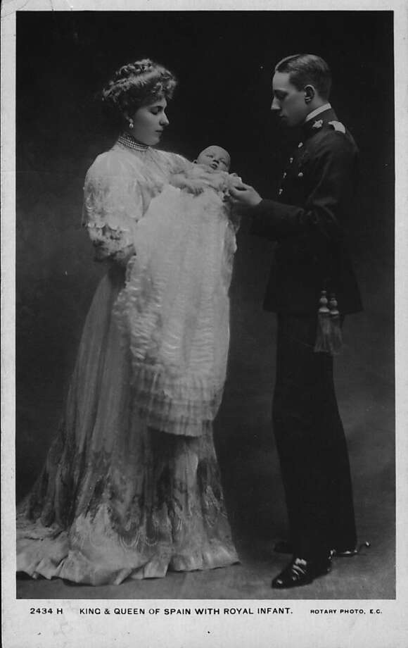 Queen Victoria Eugenie of Spain, (1887 - 1969), and her husband King Alfonso XIII of Spain (1886 - 1941) with their newly-born child,circa 1908. Photo: Hulton Archive