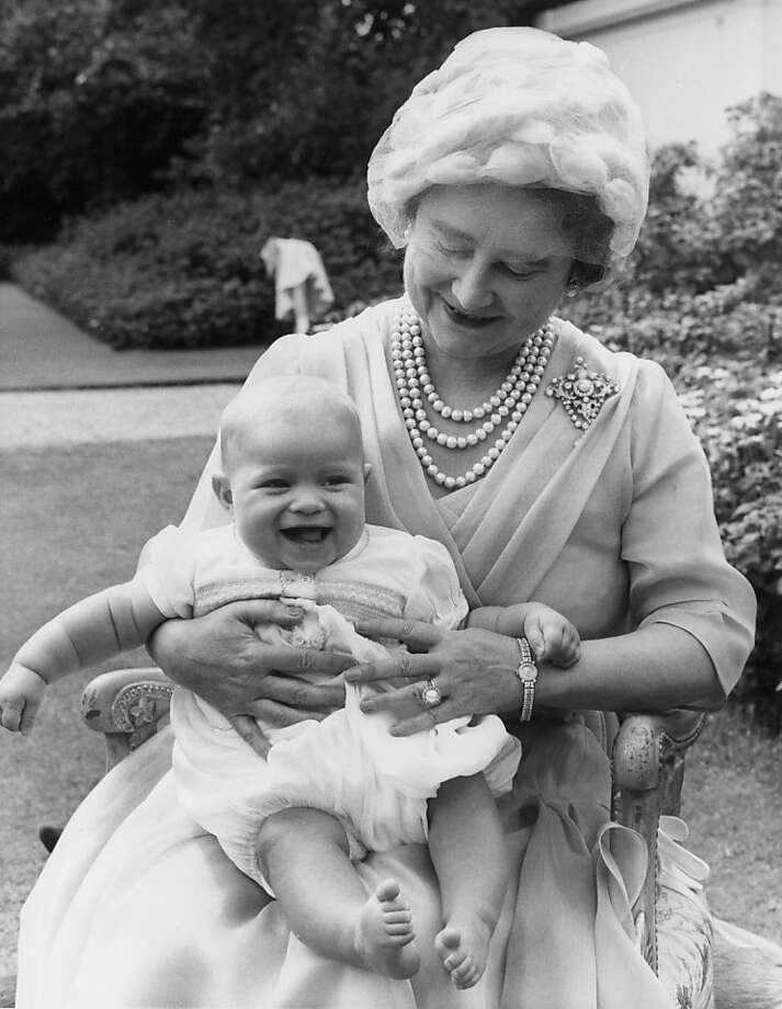 Elizabeth, the Queen Mother (1900 - 2002) holds her six-month-old grandchild Andrew on her lap during her 60th birthday celebrations at Clarence House, London on August 4, 1960. Photo: Central Press