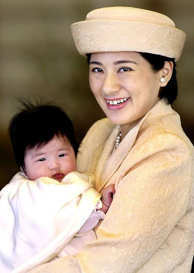 Japanese Crown Princess Masako holds her three-month-old baby, Princess Aiko, March 14, 2002 at the Imperial Palace in Tokyo, Japan. Photo: Getty Images
