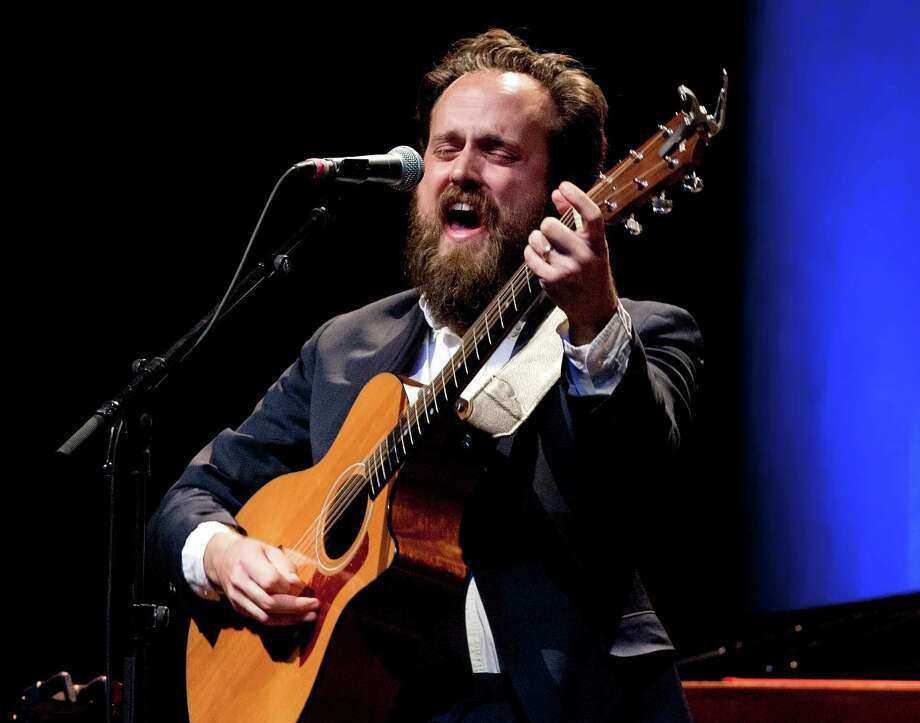 "Iron and Wine is a solo act by singer Sam Beam. Active on the indie music scene since 2002, Iron and Wine recently contributed a track to Disney's film, ""The Lone Ranger"" and released the latest album, ""Ghost on Ghost,"" this year. Photo: Frank Hoensch, Getty / 2013 Frank Hoensch"