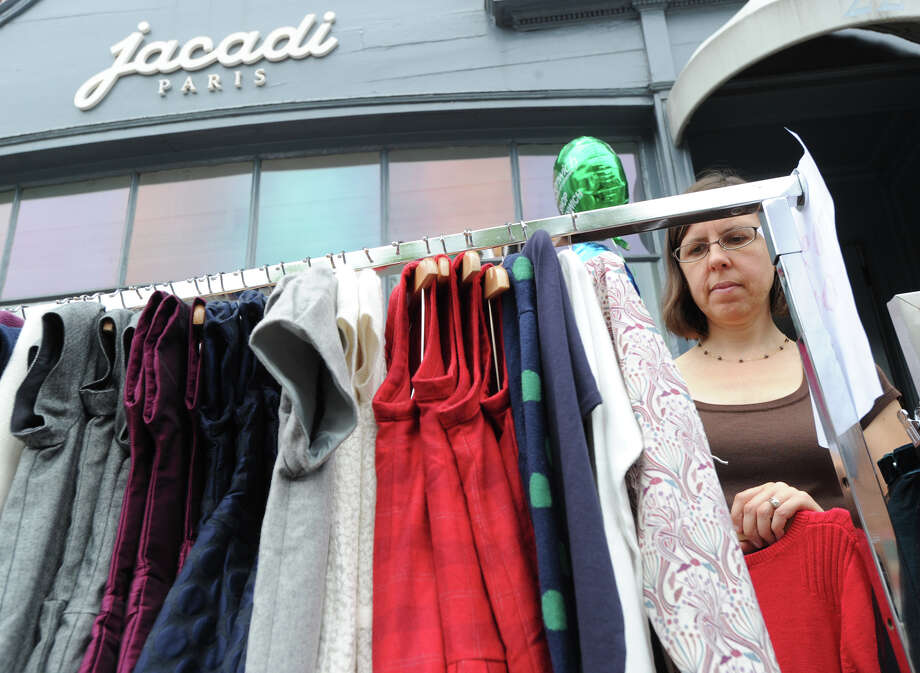 Laura Milliot of Westchester, N.Y., shops for sweaters at Jacadi Paris during the annual Greenwich Sidewalk Sales in the central business district of Greenwich, Thursday, July 11, 2013.  Photo: Bob Luckey / Greenwich Time