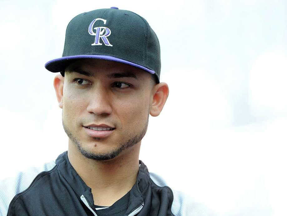 4. Carlos Gonzalez, Colorado RockiesAge: 27 | Position: left fielder Photo: G Fiume, Getty Images / 2013 G Fiume